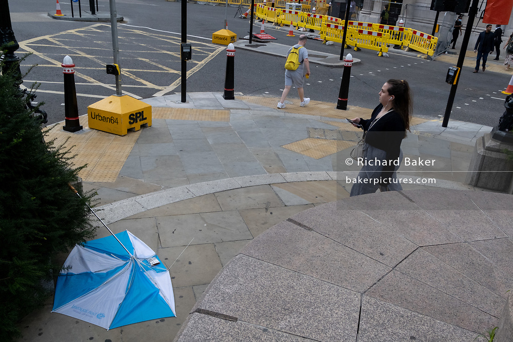 A collapsed brolly lies abandoned on the ground at Bank triangle in the City of London after strong gusts of wind from Storm Ellen passed through the capital's financial district, on 21st August 2020, in London, England.