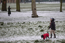 ©️ Licensed to London News Pictures. 08/02/2021. London,UK. Members of the public walk through Victoria Park in east London during a snow shower in Bank, central East London. Snow is expected for large parts of the UK and a yellow weather warning is in place in parts of England as Storm Darcy hits the UK. Photo credit: Marcin Nowak/LNP