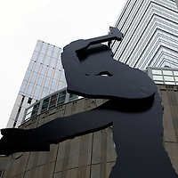 USA, Washington, Seattle, Sculpture of the Hammering Man at the Seattle Art Museum entrance.