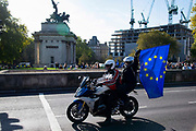 A motorcyclist flies the EU flag as over one million protesters take part in a march by the People's Vote Campaign in central London on 19th October 2019, calling for a final say in a second referendum on Brexit. MPs hold a rare Saturday sitting to debate Prime Minister Boris Johnson's new Brexit deal.
