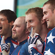 Winter Olympics, Vancouver, 2010.The USA-1 team of, from left,  Steve Mesler, Steven Holcomb, Curtis Tomasezicz, Justin Olsen win the Gold Medal in the Bobsleigh Four-man at The Whistler Sliding Centre, Whistler, during the Vancouver Winter Olympics. 27th February 2010. Photo Tim Clayton