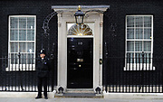 A policeman stands outside 10 Downing st during a dramatic day in British politics. Primie Miniter Gordon Brown had just offered his resignation as prime minister in an attempt to secure Labour a power-sharing government with the Liberal Democrats, May 10, 2010. The Liberal Democrats went on to do a deal with the Conservative party and formed a coalition government.