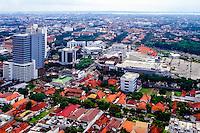 Java, East Java, Surabaya. View over Surabaya center. Surabaya Mall center front of image.  Madura in the background (from helicopter).