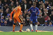 Callum Hudson-Odoi of Chelsea (20) taking on Leo Jaba of PAOK FC (98) during the Champions League group stage match between Chelsea and PAOK Salonica at Stamford Bridge, London, England on 29 November 2018.