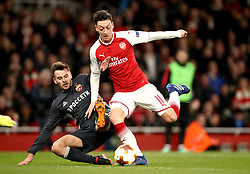 Arsenal's Mesut Ozil (right) is brought down inside the box by CSKA Moscow's Georgi Schennikov, resulting in a penalty