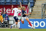 Fiona Brown (#20) of Scotland stumbles as she evades the challenge from Elvira Urazaeva (#8) of Belarus during the FIFA Women's World Cup UEFA Qualifier match between Scotland Women and Belarus Women at Falkirk Stadium, Falkirk, Scotland on 7 June 2018. Picture by Craig Doyle.