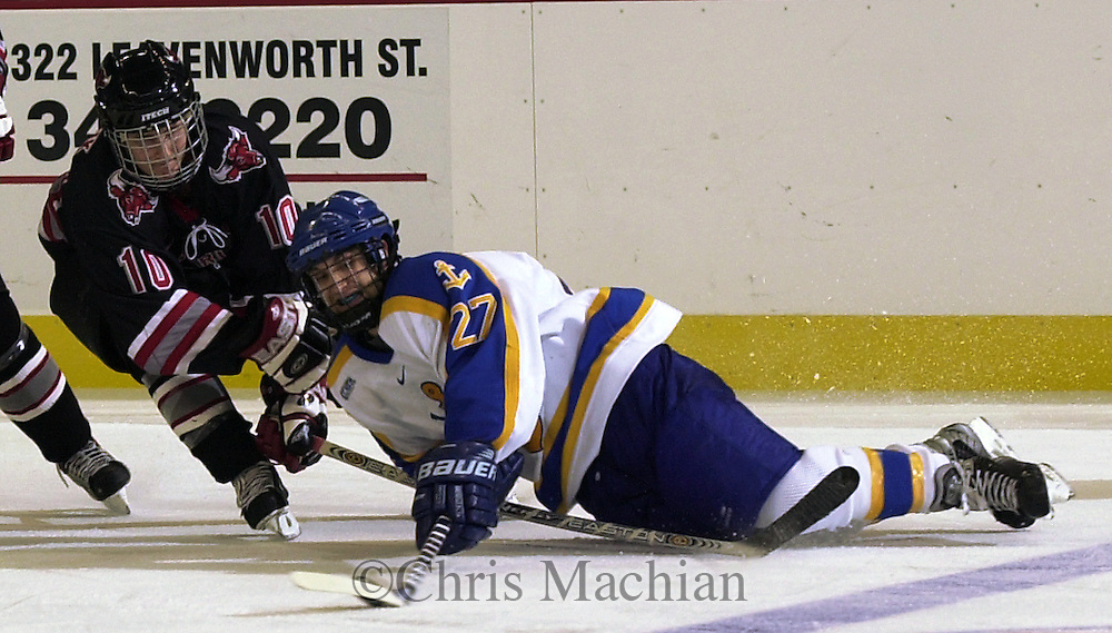 CM-11/7/03-Omaha, NE   Lake Superior State's Jon Booras tries to keep the puck from University of Nebraska at Omaha's Jason Krischuk during Friday nights game at Qwest Center Omaha.(Photo by Chris Machian/Prairie Pixel Group)