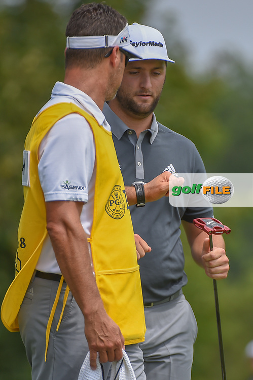 Jon Rahm (ESP) gets a fist bump from caddie Adam Hayes after sinking his birdie putt on 1 during 1st round of the 100th PGA Championship at Bellerive Country Club, St. Louis, Missouri. 8/9/2018.<br /> Picture: Golffile | Ken Murray<br /> <br /> All photo usage must carry mandatory copyright credit (© Golffile | Ken Murray)