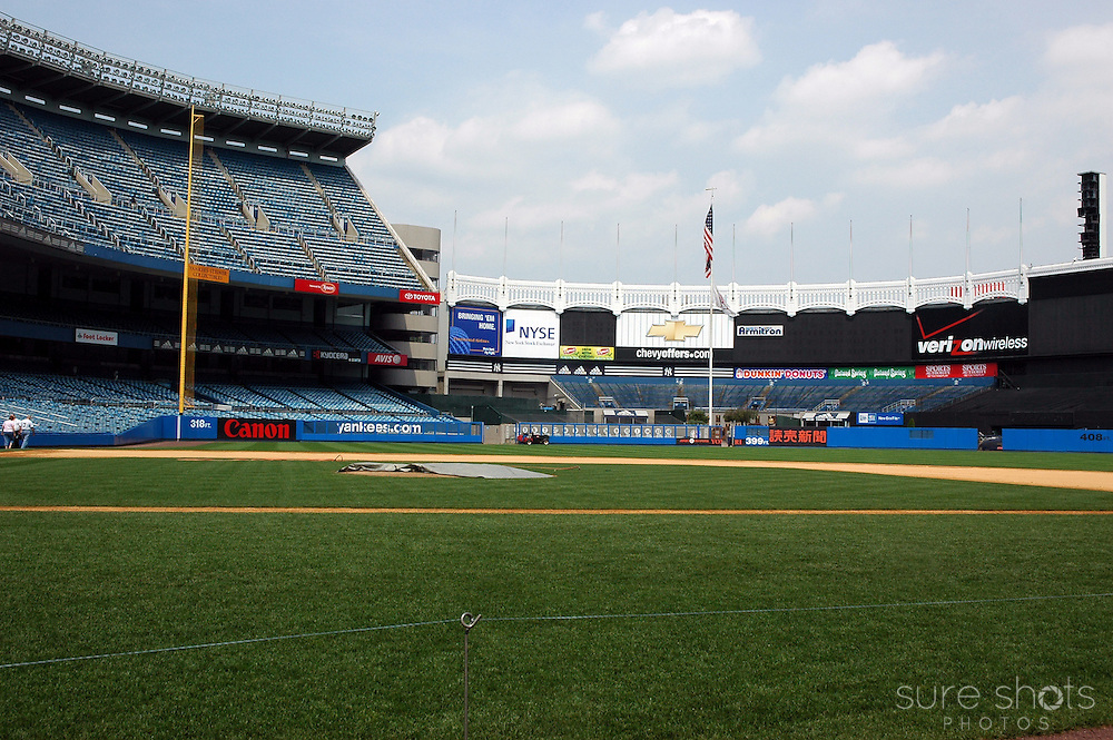 Original Yankee Stadium outfield as seen from the Yankees dugout.  Monument Park is visible behind the left field wall. This picture was taken during the last year the Yankees played in this famous stadium.