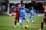 Peterborough United forward Matt Godden (9) gets in a shot during the EFL Sky Bet League 1 match between Peterborough United and Walsall at London Road, Peterborough, England on 22 December 2018.