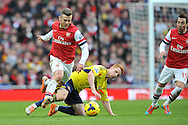 Arsenal's Jack Wilshere breaks away from Sunderland's Jack Colback during the Barclays Premier League , Arsenal v Sunderland at the Emirates Stadium in London, England on Saturday 22nd Feb 2014.<br /> pic by John Fletcher, Andrew Orchard sports photography.