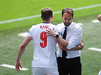 Football - 2021 EUFA European Championships - Finals - Group D - England vs Croatia, Wembley Stadium<br /> <br /> England manager, Gareth Southgate celebrates with Harry Kane at the final whistle<br /> <br /> Credit : COLORSPORT/Andrew Cowie