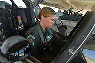 Air Force Lt. Col. Allison Patak does her pre-flight checks at the beginning training flight from Joint Base San Antonio Roandolph.