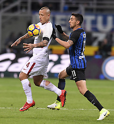 MILAN, Jan. 22, 2018  Roma's Radja Nainggolan (L) competes with Inter Milan's Matias Vecino during a Serie A soccer match between Inter Milan and Roma in Milan, Italy, Jan. 21, 2018. The game ends with a 1-1 tie. (Credit Image: © Alberto Lingria/Xinhua via ZUMA Wire)