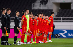 HELSINKI, FINLAND - Thursday, September 3, 2020: Wales players sing the national anthem before the UEFA Nations League Group Stage League B Group 4 match between Finland and Wales at the Helsingin Olympiastadion. (Pic by Jussi Eskola/Propaganda)