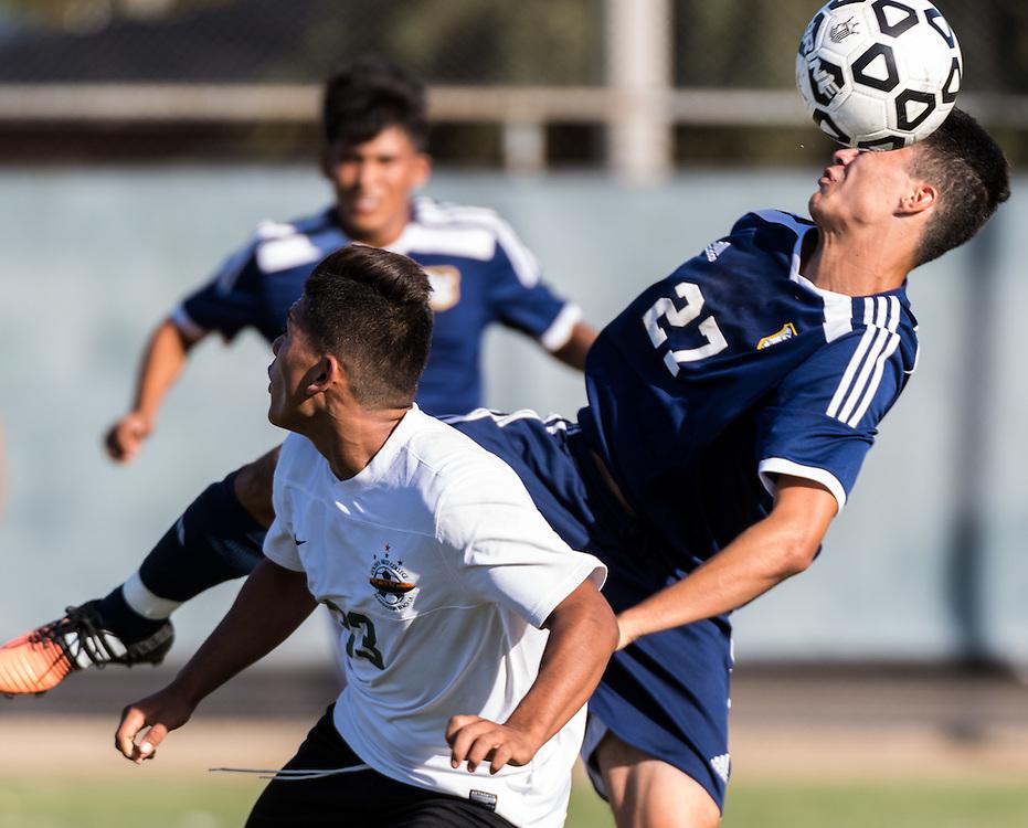 November 4, 2016 - Fullerton, CA - Fullerton College Freshman Midfielder Armando Torres (27) takes a header in a loss to Golden West College 0-2
