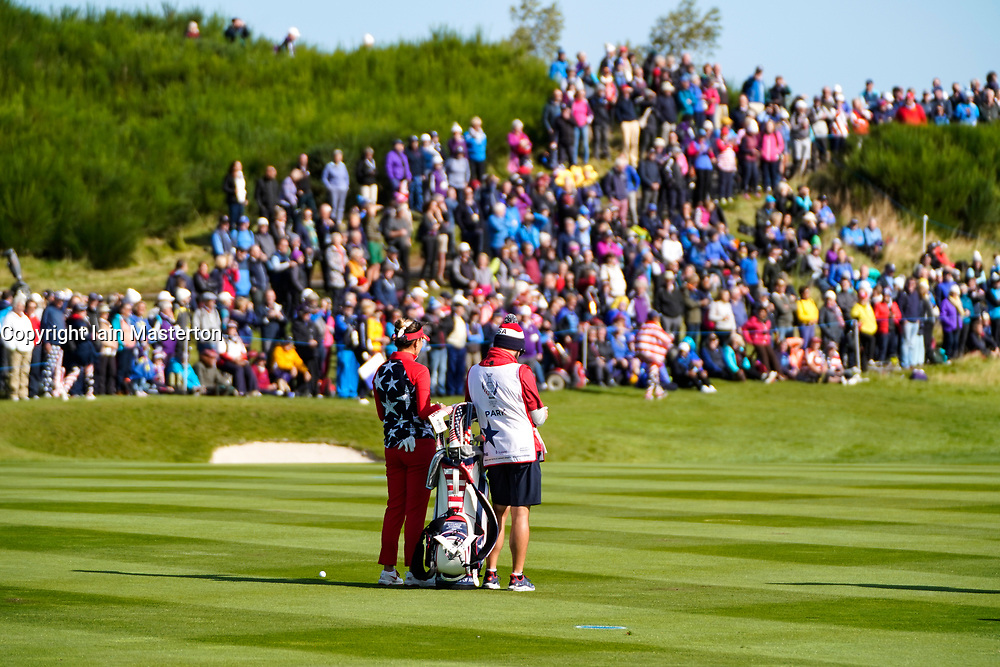 Solheim Cup 2019 at Centenary Course at Gleneagles in Scotland, UK. Annie Park of USA waits to play approach to 9th hole in front of large group of spectators during the Friday Morning Foursomes.