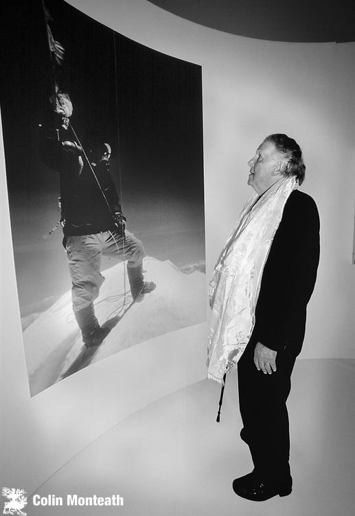 Sir Edmund Hillary views his own 1953 photograph of Tenzing Norgay on summit Mt Everest, Otago museum, Dunedin.