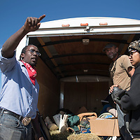 Form left, Kern Collymore, Rob Eldridge and Shannon James divide the donations of food and clothing to the different camps at the protest site for the Dakota Access Pipeline in Standing Rock North Dakota Monday.