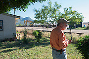 Tom Short looks out over a Pumpco site just feet from his home that will be used for a future natural gas pipeline in Alpine, Texas on June 17, 2015. (Cooper Neill for The Texas Tribune)