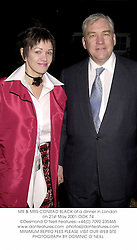 MR & MRS CONRAD BLACK at a dinner in London on 21st May 2001.	OOK 74