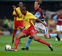 Photo: Richard Lane.<br />Watford v Aston Villa. The Barclays Premiership. 16/09/2006. <br />Watford's Ashley Young is challenged by Villa's Stephen Davis.