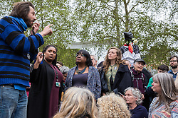 London, UK. 24th April 2019. George Barda asks a question to Diane Abbott MP, Shadow Home Secretary, at an assembly of climate change activists from Extinction Rebellion in Parliament Square on the tenth day of the International Rebellion to call on the British government to take urgent action to counter climate change.