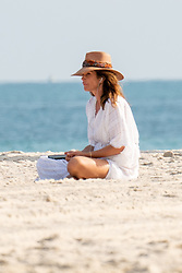 *PREMIUM EXCLUSIVE NO WEB UNTIL 1430 EST JAN 2ND* Cindy Crawford and Rande Gerber are spotted on the beach in Miami on the last day of the decade. The pair who are in town for New Year's Eve are seen in casual workout gear earlier in the day, stopping to say hi to a guy along the path. Then, as they head to lay on the sand Crawford, 53 switches to a white linen cover up while Gerber simply removes his shirt, exposing his chiseled abs, not bad for a 57 year-old. The parents of Kaia Gerber have been in the news of late as reports of their concern over Kaia's choice in men, namely, Pete Davidson, who's built a bit of a reputation for himself in recent years as a troubled young man. Cindy and Rande seem as in love as ever, sharing a bottle of water on the beach before heading up to get ready for tonight's festivities. 31 Dec 2019 Pictured: Cindy Crawford. Photo credit: BackGrid/MEGA TheMegaAgency.com +1 888 505 6342