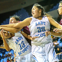 Window Rock Scout Kimberly Pablo (13), left, ducks as Ganado Hornet Amber James (20) reaches for a ball ahead of Scout Britney Shirley (30) and Hornet Mariah Cook (24) during the Tournament of Champions at the Window Rock Scout Event Center in Fort Defiance Wednesday