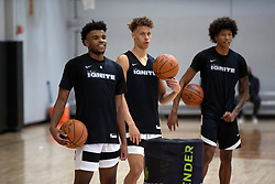 G League Ignite's Jaden Hardy, from left, Dyson Daniels and MarJon Beauchamp listen to their coaches during a practice with the team on Tuesday, Sept. 28, 2021 in Walnut Creek, Calif.