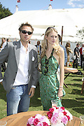 Poppy Delavigne and Dan Philipson, Cartier International Polo. Guards Polo Club. Windsor Great Park. 30 July 2006. ONE TIME USE ONLY - DO NOT ARCHIVE  © Copyright Photograph by Dafydd Jones 66 Stockwell Park Rd. London SW9 0DA Tel 020 7733 0108 www.dafjones.com
