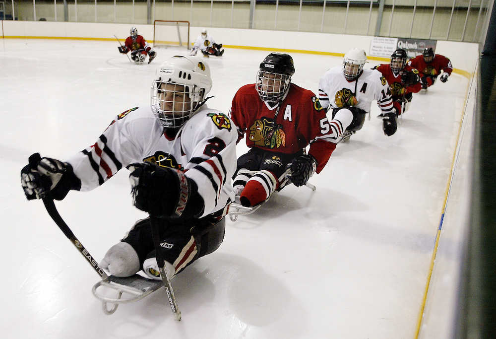 Members of the RIC Blackhawks Sled Hockey Team led by Brian Ruhe practice in Winnetka, Illinois.  Sled hockey players use short hockey sticks to propel themselves around the ice and shoot. The team run by the Rehabilitation Institute of Chicago was formed in 1999 and is now the top team in the United States.  They compete internationally on a regular basis.
