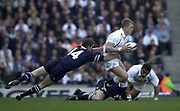 Twickenham, Surrey, 22nd March 2003,  RFU Twickenham Stadium, England, [Mandatory Credit; Peter Spurrier/Intersport Images]<br /> <br /> RBS Six Nations Rugby England v Scotland<br /> Josh Lewsey tackled by Chris Pattersen  - moving the ball out