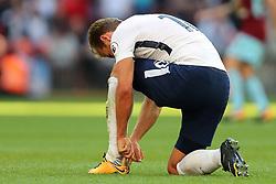 27 August 2017 - Premier League Football - Tottenham Hotspur v Burnley - Harry Kane of Tottenham pulls on the back of his boot - Photo: Charlotte Wilson
