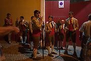 "A group of Portugese Forcados stand outside the bullring and show their camaraderie before the evening's bullfight (Corrida de Touros), on 15th July 2016, at Caldas da Rainha, Portugal. A forcado is a member of a group of men that performs the pega de cara or pega de caras (""face catch""), the final event in a typical Portuguese bullfight. They were initially professionals from lower classes but nowadays people from all social backgrounds practice their art through amateur groups. In the Portuguese version, unlike Spanish bullfights, the bull is not killed. (Photo by Richard Baker / In Pictures via Getty Images)"