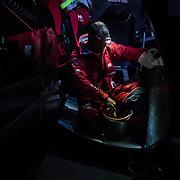 Leg 3, Cape Town to Melbourne, day 03,  Pablo Arrarte bails water on board MAPFRE. Photo by Jen Edney/Volvo Ocean Race. 16 December, 2017.