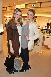 Left to right, GRETA BELLA MACINA and AMBER ATHERTON at the launch of the new John Lewis Beauty Hall, John Lewis, Oxford Street, London on 8th May 2012.