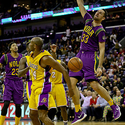 Feb 4, 2016; New Orleans, LA, USA; New Orleans Pelicans forward Ryan Anderson (33) dunks over Los Angeles Lakers forward Kobe Bryant (24) during the second half of a game at the Smoothie King Center. The Lakers defeated the Pelicans 99-96. Mandatory Credit: Derick E. Hingle-USA TODAY Sports
