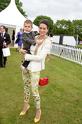 SASKIA WINBERGH and her son RIVER at the 2013 Cartier Queens Cup Polo at Guards Polo Club, Berkshire on 16th June 2013.