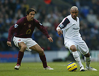 Photo: Aidan Ellis.<br /> Bolton Wanderers v Arsenal. The Barclays Premiership.<br /> 03/12/2005.<br /> Bolton's El Hadji Diouf and Arsenal's Robert Pires