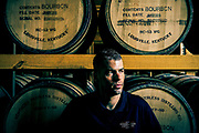 Carson Taylor, president of Peerless Distillery poses for a portrait inside his first batch of aging bourbon barrels at their North 10th Street location.