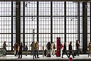 people wait on the platform at Berlin's Friedrichstrasse rail station, Berlin, Germany, April 05, 2012.