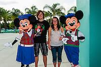 Mickey Mouse and Minnie Mouse with teenagers, Fantasia Gardens miniature golf course, Walt Disney World, Orlando, Florida USA