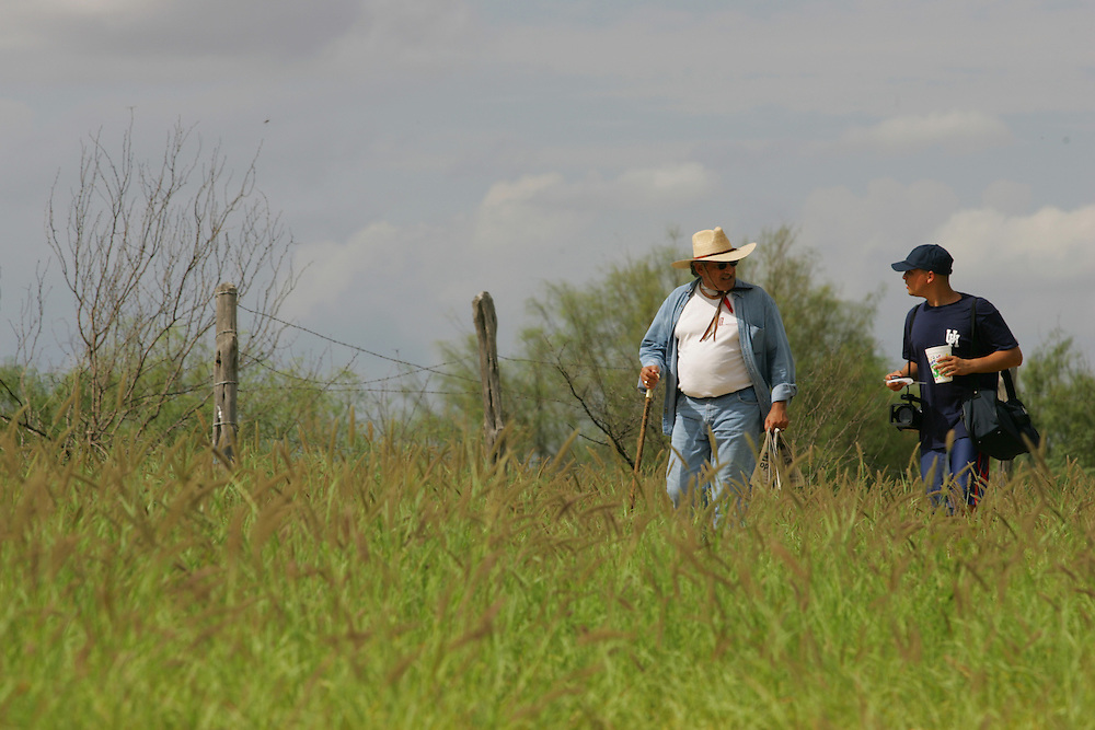 Jay Johnson Castro leaves Laredo with documentary filmmaker Jesse Salmeron at his side.  Castro said he was walking over 200 miles from Laredo to Brownsville to protest the proposed border wall along the Rio Grande.