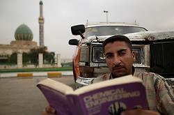 Yassin Abbas, 25, a taxi driver and chemical engineering student, is seen in Baghdad, Iraq, March 6, 2004.