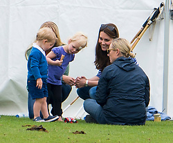 © Licensed to London News Pictures. 14/06/2015. Prince George of Cambridge and his mother Catherine Duchess of Cambridge talking to Autumn Phillips  and Daughter Savannah Phillips, with Zara Phillips . British Royals attend a charity Polo match in Tetbury,  Gloucestershire, UK. Photo credit: Ben Cawthra/LNP