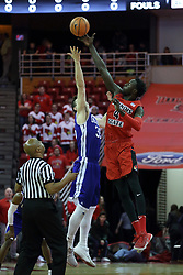 """21 February 2018:  Nick McGlynn and Daouda """"David"""" Ndiaye perform the opening jump ball thrown by Zelton Steed during a College mens basketball game between the Drake Bulldogs and Illinois State Redbirds in Redbird Arena, Normal IL"""