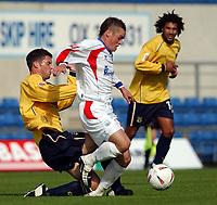 Photo: Daniel Hambury.Digitalsport<br /> Coca Cola League Two<br /> Oxford United V Rushden & Diamonds .  11/9/2004.<br /> <br /> <br /> Oxford United's Jamie Hand tackles Rushden & Diamonds' Gary Mills. The Rushden player was taken off injured.