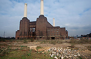 A 1998 landscape showing a derelict wasteland of ground around Battersea Power Station, on 25th March 1998, in London, England.