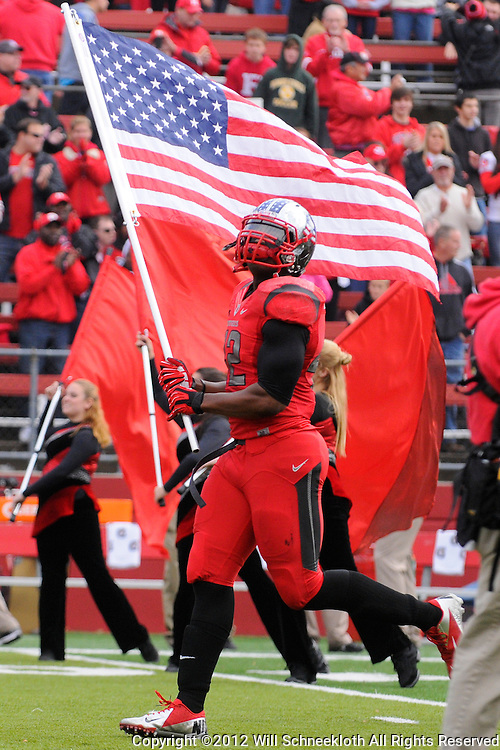 10 November 2012: Rutgers Scarlet Knights linebacker Steve Beauharnais (42) carries the American Flag onto the field during NCAA college football action between the Rutgers Scarlet Knights and Army Black Knights at High Point Solutions Stadium in Piscataway, N.J..
